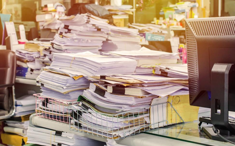 unorganized pile of paperwork