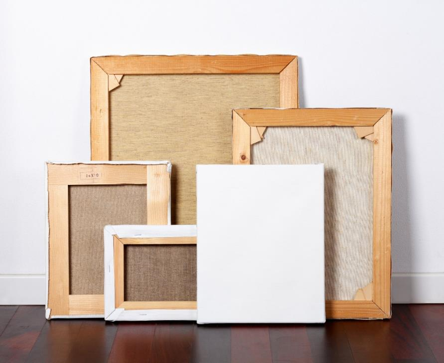 Picture frames leaning against a wall