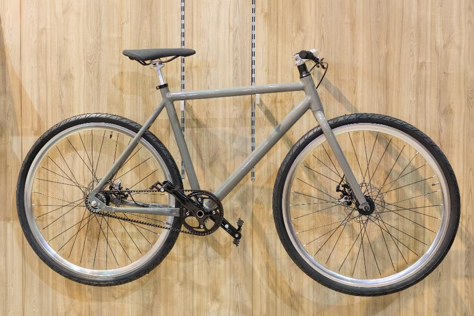 A bicycle hanging from wall.
