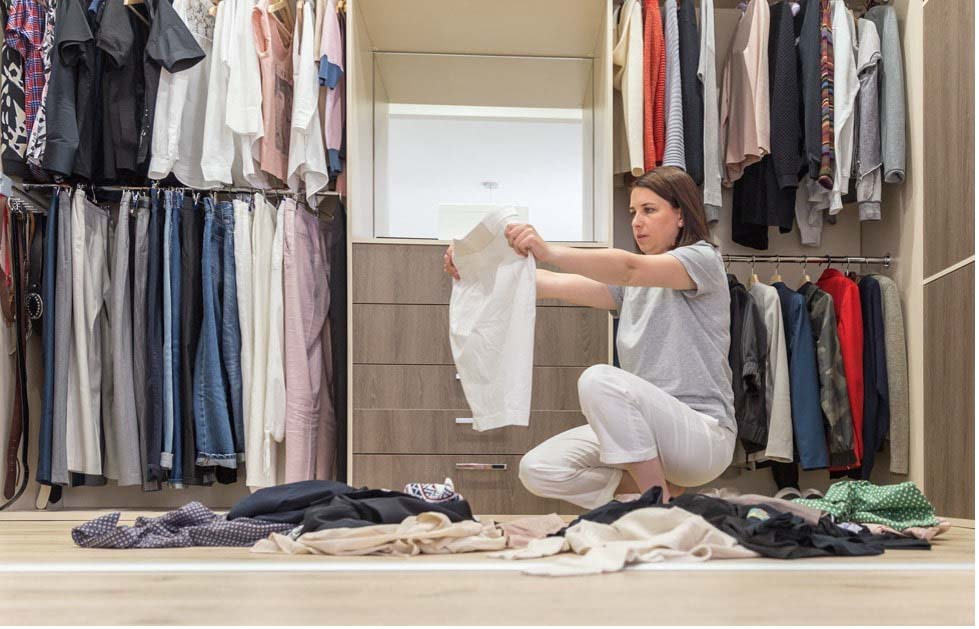 Woman going through clothes.